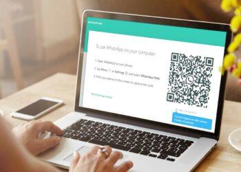 waspada 'pencurian' data pada whatsapp - rear view of high school girl using laptop for doi CLLLCZF 350x250 - Waspada 'Pencurian' Data Pada WhatsApp