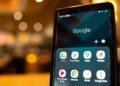 google Playstore, pembayaran google Playstore tidddak berhasil keuntungan menggunakan ovo - smartphone with google application icons on the screen blurred cafe interior on a background t20 zWG73G 120x86 - Keuntungan Menggunakan OVO