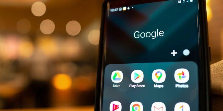 google Playstore, pembayaran google Playstore tidddak berhasil pembayaran google playstore tidak berhasil - smartphone with google application icons on the screen blurred cafe interior on a background t20 zWG73G 750x375 - Cara mengatasi Pembayaran google Playstore Tidak Berhasil