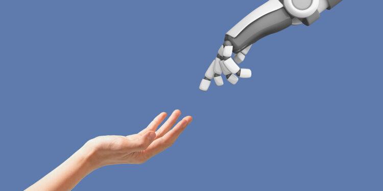 keuntungan kerugian ai keuntungan dan kerugian artificial intelligence - human hand and robot hand with empty space on blue FSWGCZT 750x375 - Keuntungan dan Kerugian Artificial Intelligence