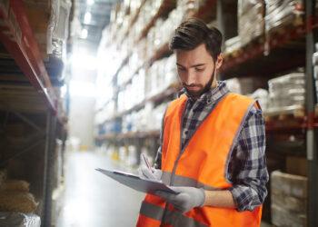 Distribution manager making revision of goods in storehouse Cara Menjadi Eksportir Pemula yang Sukses - work in warehouse UWZJM5G 350x250 - Cara Menjadi Eksportir Pemula yang Sukses