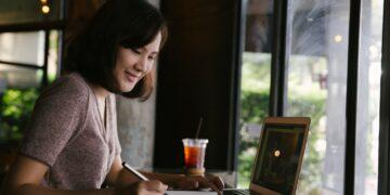 Cara Menjadi Eksportir Pemula yang Sukses - young business woman in casual dress sitting at table in cafe and writing in notebook t20 lRkA2b 360x180 - Cara Menjadi Eksportir Pemula yang Sukses